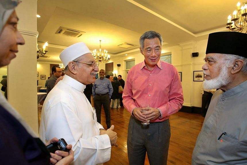 Prime Minister Lee Hsien Loong with participants of a two-hour dialogue over the tudung. The Government's position on the tudung is not static, but Singapore cannot take actions precipitously that can have unintended consequences, said Mr Lee after t