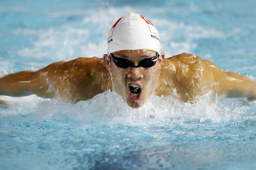 Nicholas Tan won the men 100m butterfly event final in 54.79 sec and misses Beijing Olympic place by a touch on June 6, 2008. -- ST FILE PHOTO: ALBERT SIM