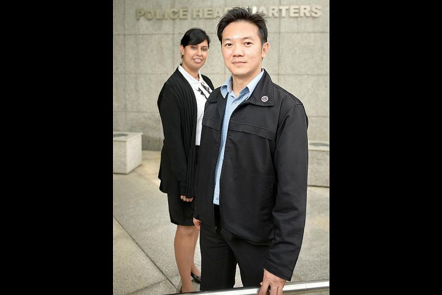 Volunteer police para-counsellors Dalip Kaur and Jason Loke are trained to help their colleagues deal with personal issues, whether marital, financial or work-related. Para-counsellors go through a rigorous selection process. -- ST PHOTO: DESMO