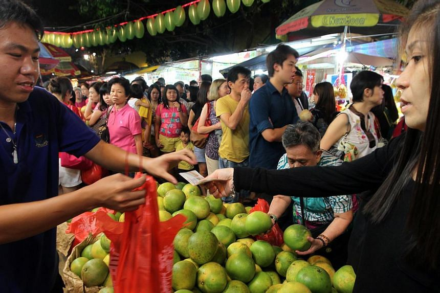 Crowds shopping for Chinese New Year goods at the Chinatown bazaar yesterday. Businesses such as Chinese restaurants are pulling out the stops for customers during this festive season, which is the busiest time of the year. Many are getting staff to