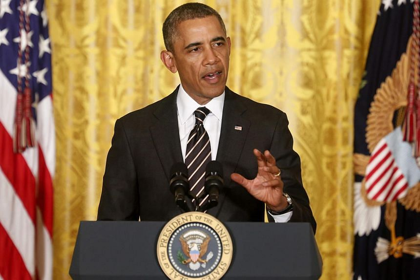 US President Barack Obama delivering remarks at a reception with US mayors at the White House in Washington on Jan 23, 2014. Mr Obama will announce a new plan next week to help Americans who continue to struggle to find jobs even as the economy recov