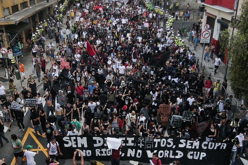 """People at the """"Nao Vai Ter Copa"""" (The Cup will not take place) protest along Avenue Paulista, in Sao Paulo, Brazil, on Jan 25, 2014. Brazil saw on Saturday the first in a wave of planned protests against its hosting of the World Cup, after acti"""