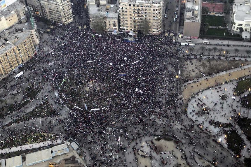 An aerial view made from an Egyptian army helicopter shows a general view of supporters of Egypt's army and police gathering at Tahrir Square in Cairo, on the third anniversary of Egypt's uprising, on Jan 25, 2014. At least 29 people were killed in c