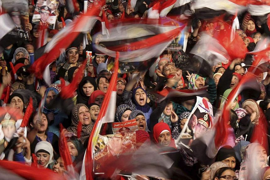 Supporters of Egypt's army and police gather at Tahrir square in Cairo, on the third anniversary of Egypt's uprising, on Jan 25, 2014. -- PHOTO: REUTERS