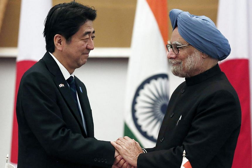 "Japan's Prime Minister Shinzo Abe (left) and his Indian counterpart Manmohan Singh after addressing the media at Hyderabad House in New Delhi on Jan 25, 2014. India and Japan on late Saturday affirmed plans to ""further strengthen"" defence cooperation"