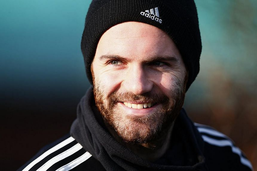 Chelsea's Juan Mata walks to a training session at the team training facility in Stoke D'Abernon to the south of London, on Dec 10, 2013. -- FILE PHOTO: REUTERS