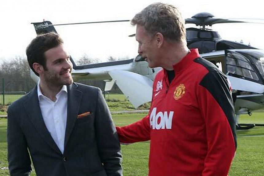 Juan Mata (left) and Manchester United manager David Moyes. -- FILE PHOTO: TWITTER