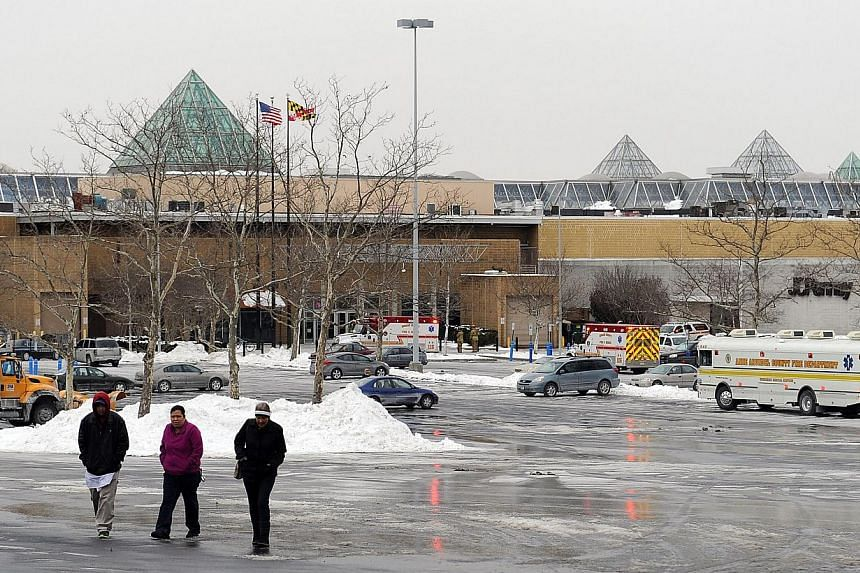 People walk outside of Columbia Town Center Mall after three people were killed in a shooting there January 25, 2014 in Columbia, Maryland. Three people were killed in a shooting at the popular shopping mall, authorities said on Saturday.&n
