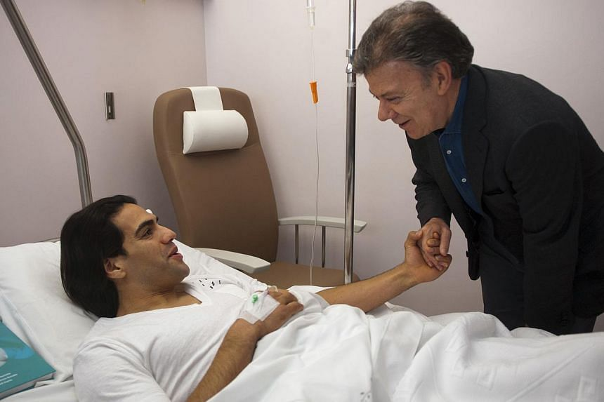 Colombia's President Juan Manuel Santos (right) visiting Colombian football player Radamel Falcao at the Trindade Hospital in Porto on Jan 25, 2014. Falcao has been given a 50-50 chance of playing at the World Cup in June after undergoing a successfu