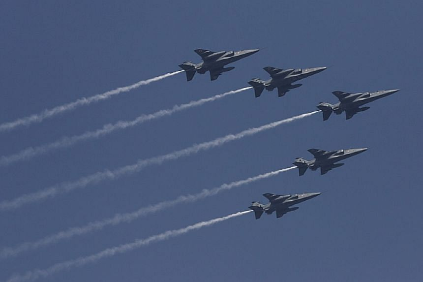 Indian Air Force Jaguar aircraft take part in the Republic Day parade in New Delhi, on Jan 26, 2014. -- PHOTO: REUTERS