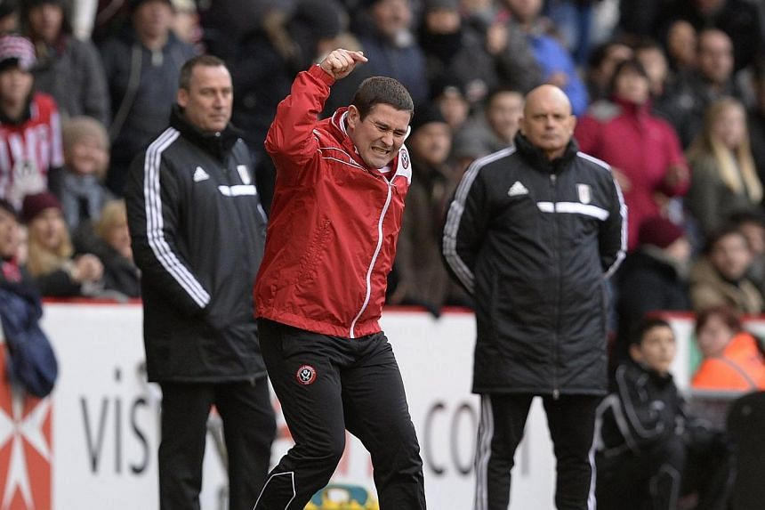 Sheffield United's manager Nigel Clough (centre) gestures during their FA Cup soccer match against Fulham at Bramhall Lane in Sheffield, northern England, on Sunday, Jan 26, 2014. Premier League side Fulham survived an FA Cup scare against third