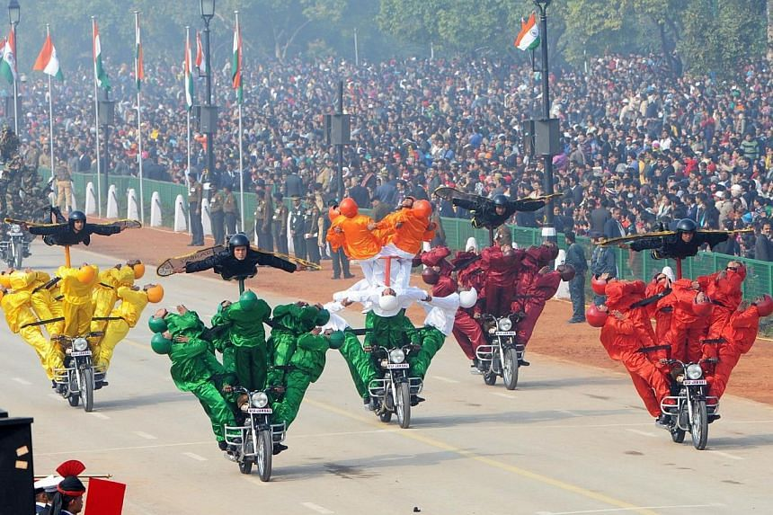 Indian Border Security Force motorcycle specialists perform during the Republic Day parade in New Delhi, on Jan 26, 2014. -- PHOTO: AFP