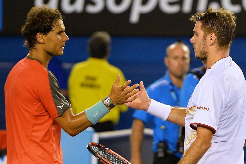 Switzerland's Stanislas Wawrinka (right) shakes hands with Spain's Rafael Nadal after his victory during the men's singles final on day 14 of the 2014 Australian Open tennis tournament in Melbourne, on Jan 26, 2014.Stanislas Wawrinka took Austr