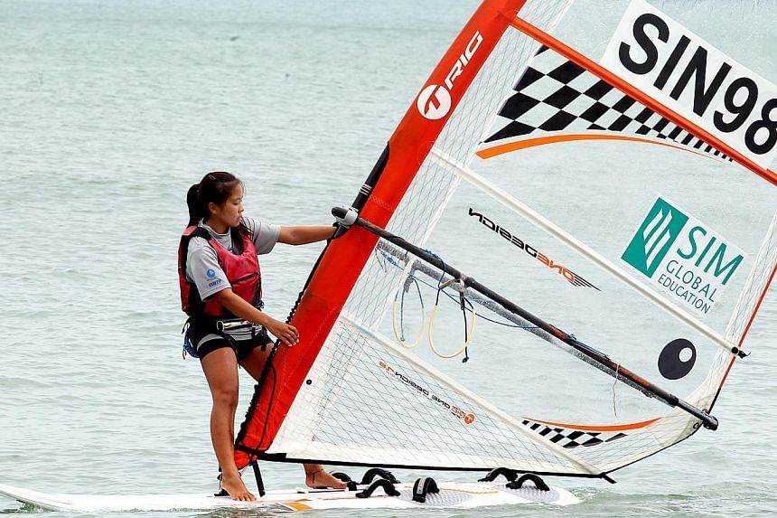 Singaporean windsurfer Ynez Lim finished third in the girl's Techno 293 class at the 33rd SIM Singapore Open Asian Windsurfing Championship to earn the Republic's girls a slot at the 2014 Youth Olympic Games. -- ST PHOTO: LAU FOOK KONG