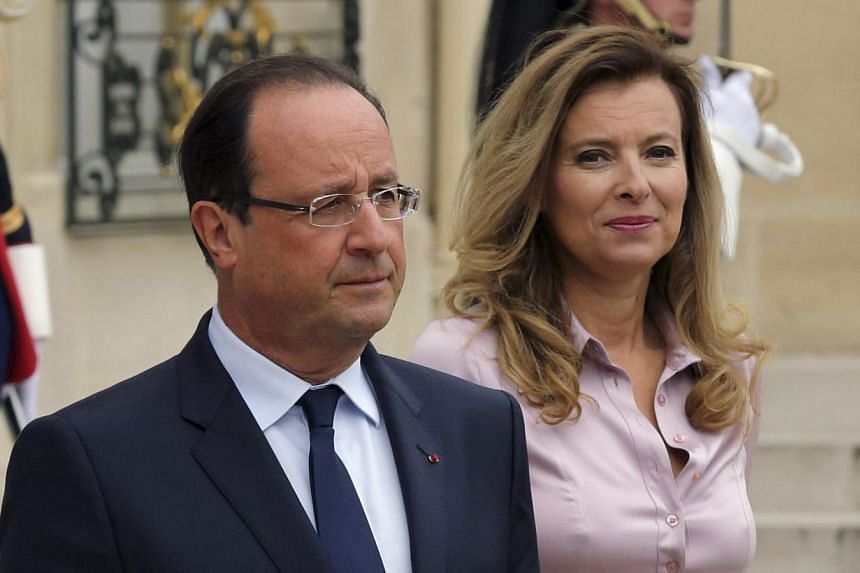 French President Francois Hollande (left) and first lady Valerie Trierweiler accompany guests following a meeting at the Elysee Palace in Paris on October 1, 2013. Mr Hollande on Sunday began a new chapter in his presidency after splitting from