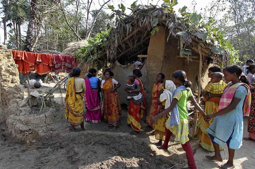Villagers walk near the area where a woman was gang-raped at Birbhum district, in the eastern Indian state of West Bengal on Jan 24, 2014.A 20-year-old woman who says she was gang-raped in an tribal region on orders of a village court has been