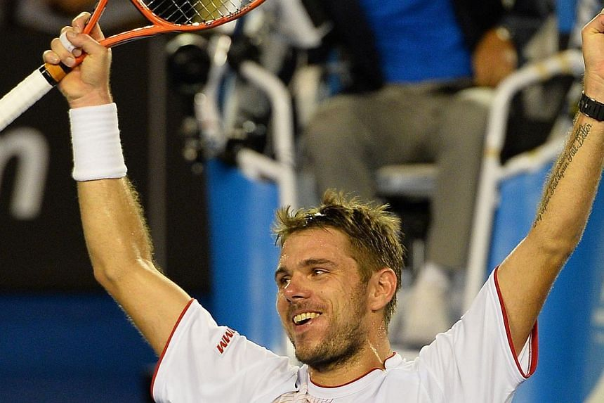 Switzerland's Stanislas Wawrinka celebrates after his victory against Spain's Rafael Nadal during the men's singles final on day 14 of the 2014 Australian Open tennis tournament in Melbourne on Sunday, Jan 26, 2014. Wawrinka upset injury-trouble