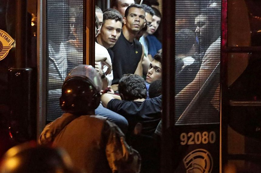 """Demonstrators are arrested during the """"Nao Vai Ter Copa"""" (You are not going to have Cup) protest in Sao Paulo, Brazil, on Jan 25, 2014. -- PHOTO: REUTERS"""