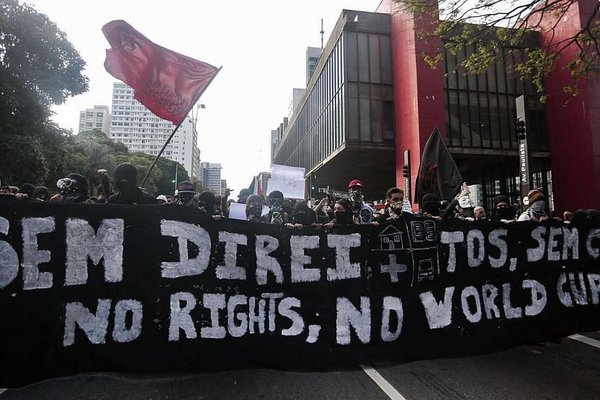 """People take part in the """"Nao Vai Ter Copa"""" (You are not going to have Cup) protest along Avenue Paulista, in Sao Paulo, Brazil, on Jan 25, 2014. -- PHOTO: REUTERS"""
