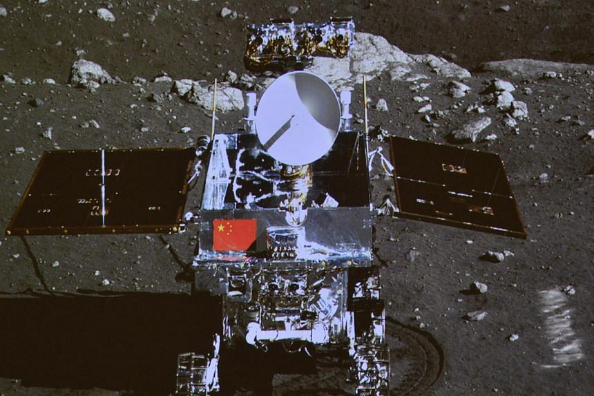 """A photograph of the giant screen at the Beijing Aerospace Control Center shows photo of the Yutu, or """"Jade Rabbit"""" lunar rover taken by the camera on the Chang'e 3 probe during the mutual-photograph process, in Beijing on December 15, 2013. State-run"""