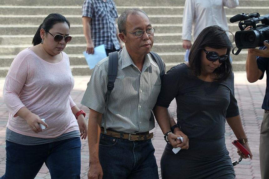 Cement-mixer driver, Munir Mohd Naim (centre), was jailed for two weeks on Monday.Munir will also be banned from driving all vehicles for five years upon his release.-- ST FILE PHOTO: LAU FOOK KONG