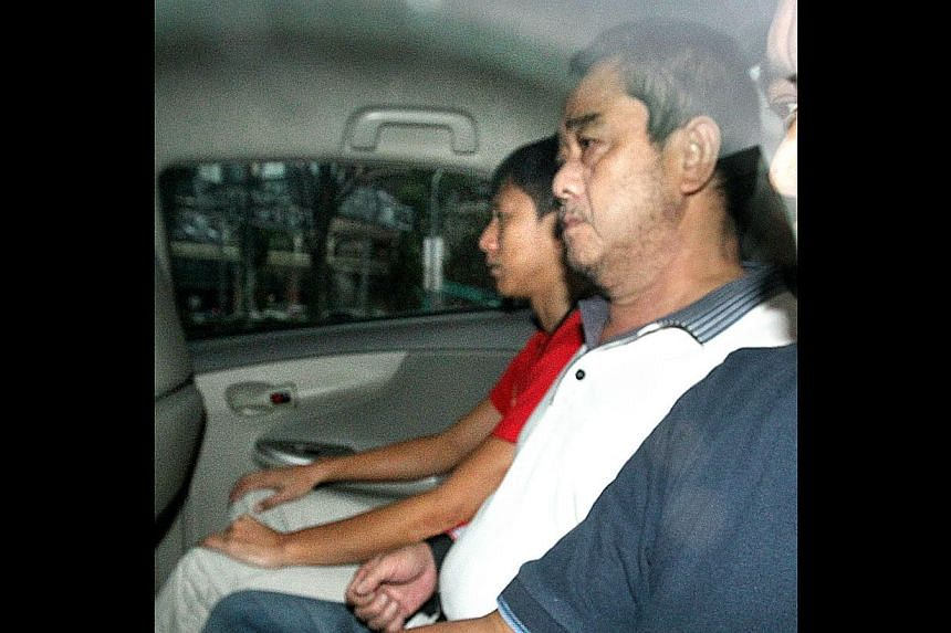 Eng Bak Siong (right) who has been on the run for more than 10 years, was brought back to Singapore from Malaysia to face a charge of murder committed in 2001.He was on the run for more than 10 years after fatally stabbing a man. The law finall