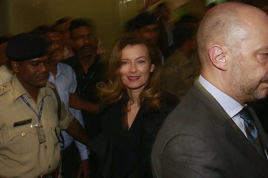 Ms Valerie Trierweiler (centre), former companion of French President Francois Hollande, arrives at the international airport in Mumbai on Jan 27, 2014. -- PHOTO: REUTERS