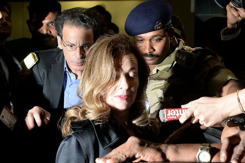 MsValerie Trierweiler (centre), the ex-partner of French President Francois Hollande, surrounded by security guards and officials, arrives at the international airport in Mumbai early on Jan 27, 2014. -- PHOTO: AFP