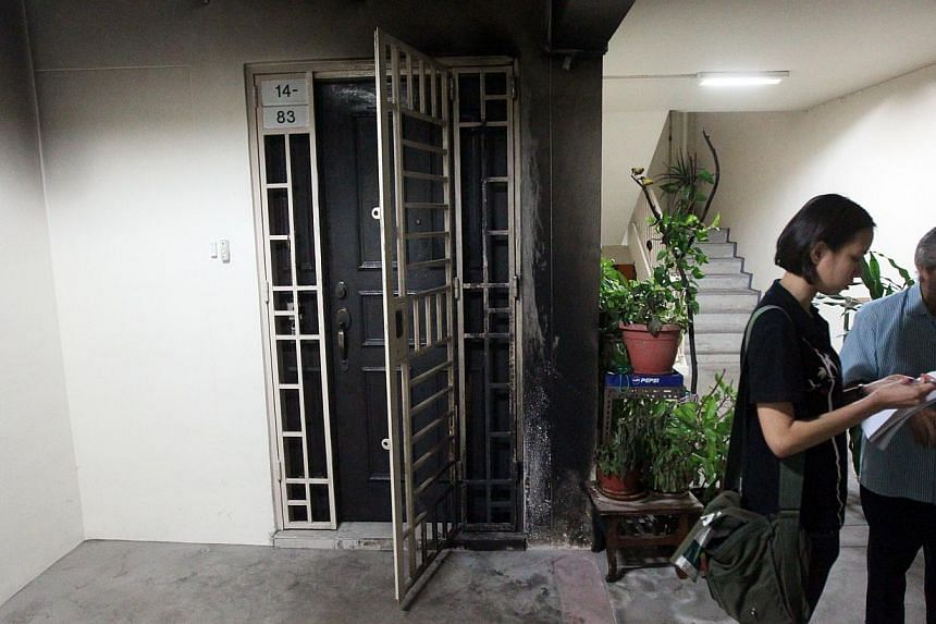 The gate and door of the Sengkang flat were badly burned in the fire. A 45-year-old cabby, who killed his former girlfriend by dousing her with petrol and setting her alight after she refused to get back together, was on Monday sentenced to 20 years