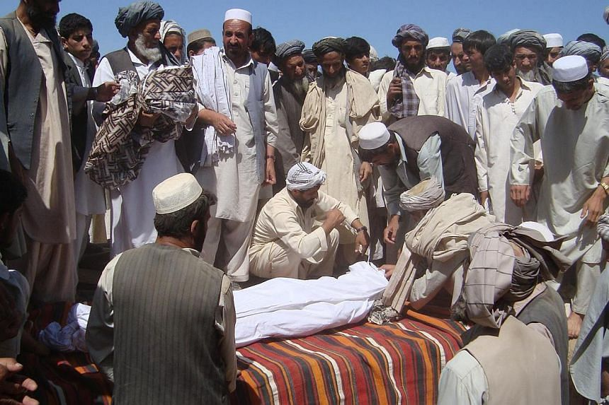 In this file photograph taken on September 4, 2009, members of the community attend a funeral after a Nato airstrike which destroyed two fuel tankers hijacked by the Taleban in northern Kunduz. A photograph the Afghan government distributed to back u