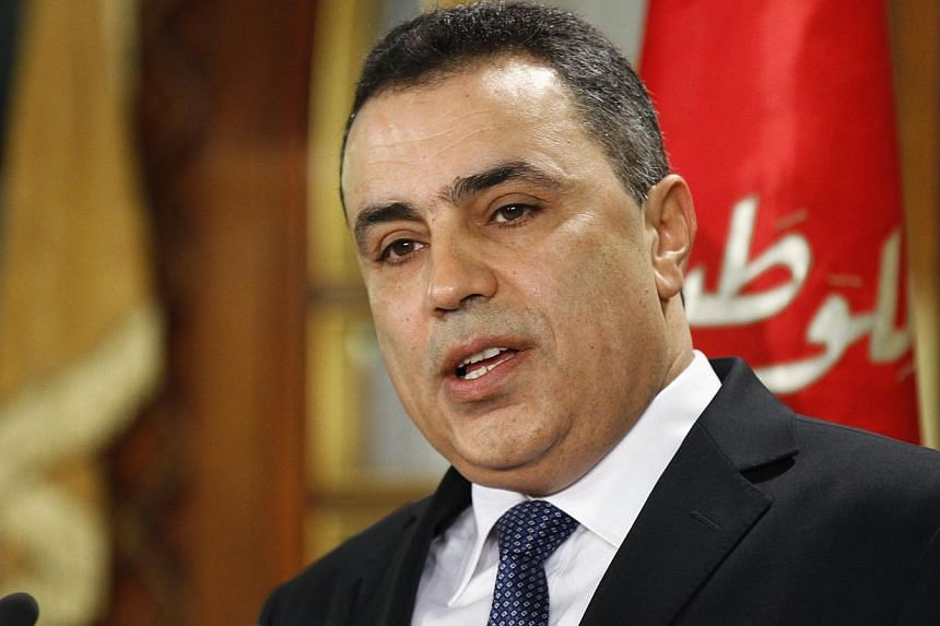 Tunisia's Prime Minister Mehdi Jomaa speaks during a news conference in Tunis on Jan 26, 2014.Tunisian premier-designate Mehdi Jomaa, who presented the president on Sunday, Jan 26, 2014, with his Cabinet of independents under a roadmap to end a