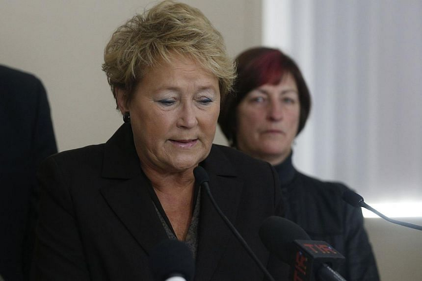 """Quebec's Premier Pauline Marois speaks during a news conference in L'Isle Verte, Quebec, on Jan 26, 2014.Ms Marois on Sunday said a fatal fire in a seniors' residence was """"unacceptable"""" but stopped short of saying her government would make spri"""
