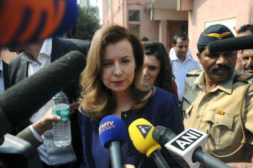 Valerie Trierweiler, the ex-partner of French President Francois Hollande, is surrounded by media after visiting the Nutrition Rehabilitation and Research Centre at a hospital in the Dharavi area of Mumbai on Jan 27, 2014. -- PHOTO: AFP