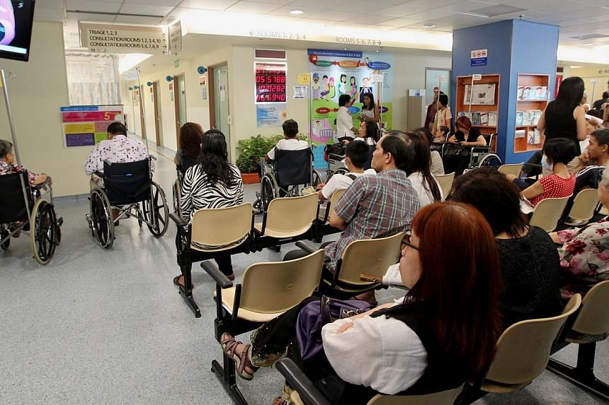 Photo showing patients waiting outside the consultation rooms at the Accident & Emergency Department at Changi General Hospital.Hit by a severe bed crunch that has patients waiting in a tent for a hospital bed, Changi General Hospital is of