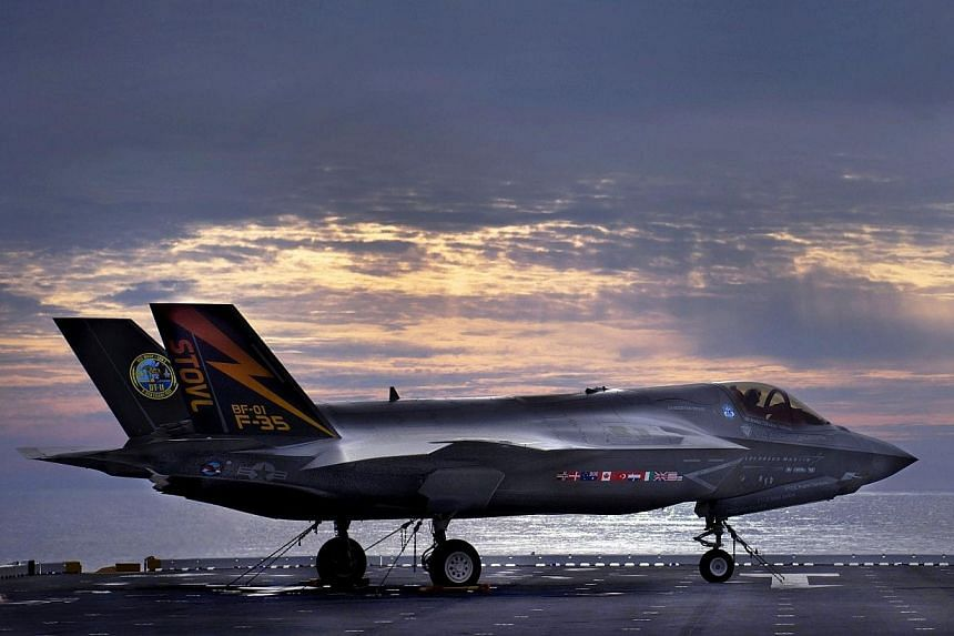 The F-35B Lighting II variant of the Joint Strike Fighter sits on the deck of the amphibious assault ship USS Wasp while being tested by Marine Corps and Lockheed Martin pilots and engineers off the coast of North Carolina in this handout photo taken