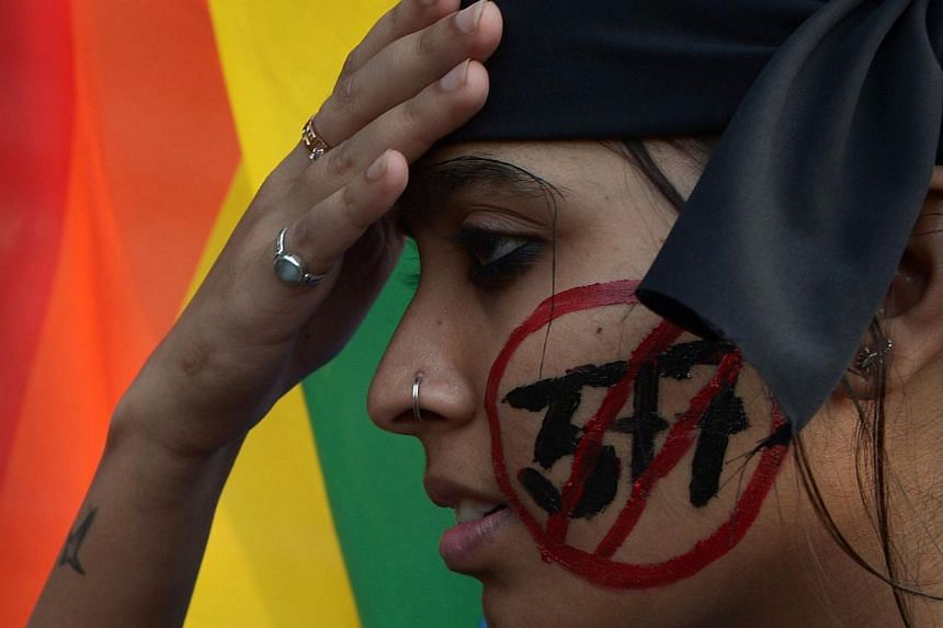 An Indian gay-rights activist takes part in a protest against a Supreme Court ruling reinstating a ban on gay sex in Kolkata. India's top court rejected Jan 28, 2014 a motion filed by the government and activist groups to review a shock ruling that r