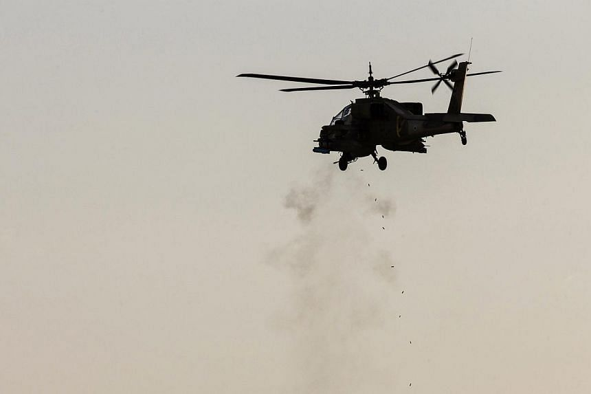 The Pentagon informed Congress on Monday, Jan 27, 2014, it plans to sell 24 Apache attack helicopters to Iraq in a deal worth US$4.8 billion (S$6.1 billion), officials said, as Baghdad battles anti-government militants. -- FILE PHOTO: REUTERS