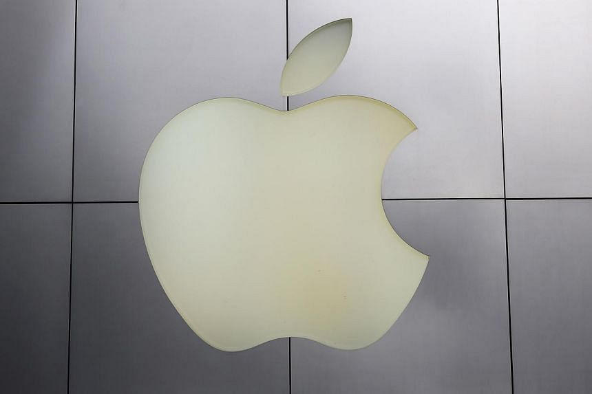The Apple logo is pictured at its flagship retail store in San Francisco, California, on Jan 27, 2014. Apple Inc sold fewer new iPhones than expected over the holidays, reflecting intense competition from arch-foe Samsung Electronics during the