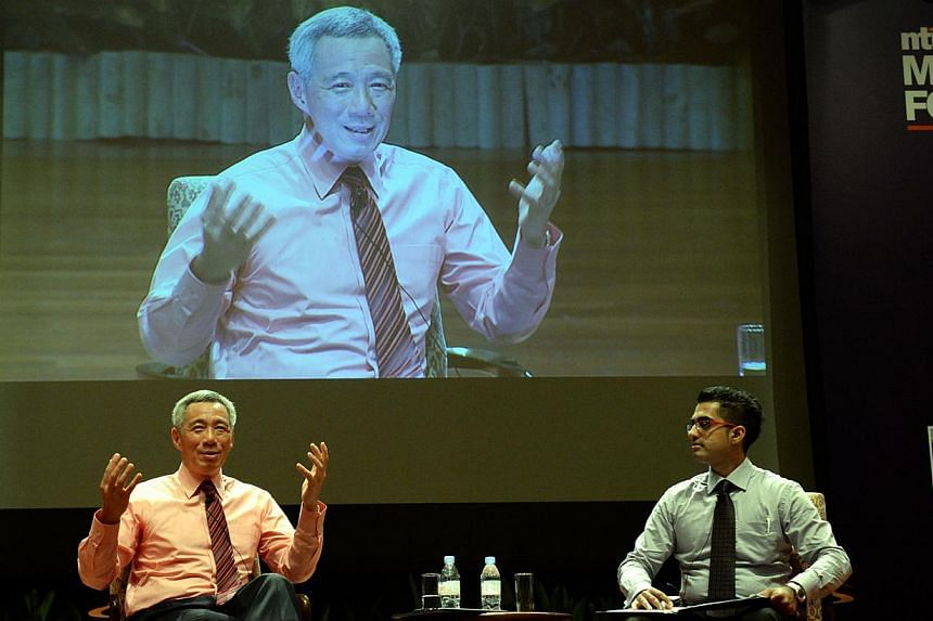 """Singapore Prime Minister Lee Hsien Loong held a dialogue session with over 1,000 university students on Tuesday night on the topic of """"Singapore - Progressing Together"""". The rise of Asia will bring uncertainty over the next 50 years, but the odds"""