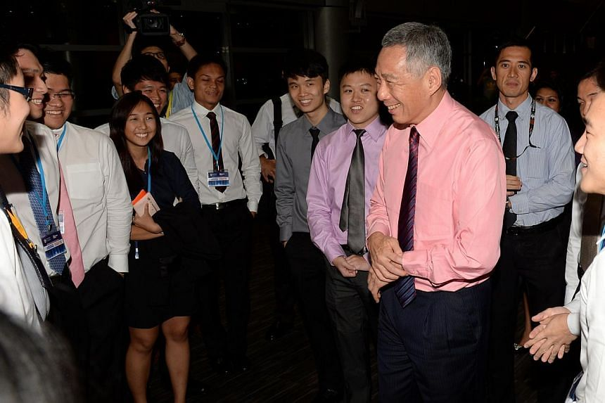 "Mr Lee held a dialogue session with over 1,000 university students on Tuesday night on the topic of ""Singapore - Progressing Together"". -- ST PHOTO: AZIZ HUSSIN"