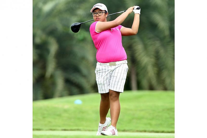 Singapore golfer Amanda Tan made history on Tuesday by becoming the youngest player to qualify for the HSBC Women's Champions competition. -- ST FILE PHOTO: SEAH KWANG PENG