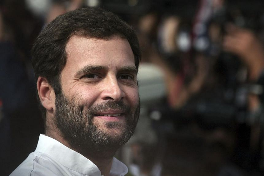 Rahul Gandhi, a lawmaker and son of India's ruling Congress party chief Sonia Gandhi, smiles as he speaks with the media in New Delhi in this March 6, 2012 file photo. -- FILE PHOTO: REUTERS