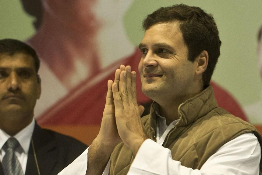 Indian Congress Party Vice President Rahul Gandhi gestures a greeting during the All India Congress Committee (AICC) meeting in New Delhi on Jan 17, 2014. -- FILE PHOTO: AFP