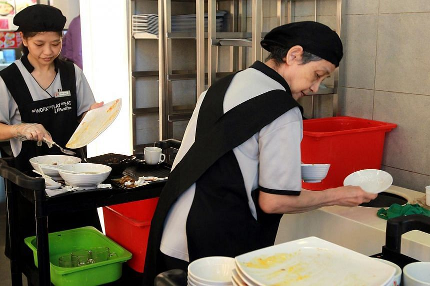 Cleaners working at the tray collection area at the foodcourt in Khoo Teck Puat Hospital. Sales assistants, waiters and cleaners were among the jobs with the most vacancies last year. -- ST FILE PHOTO: SEAH KWANG PENG