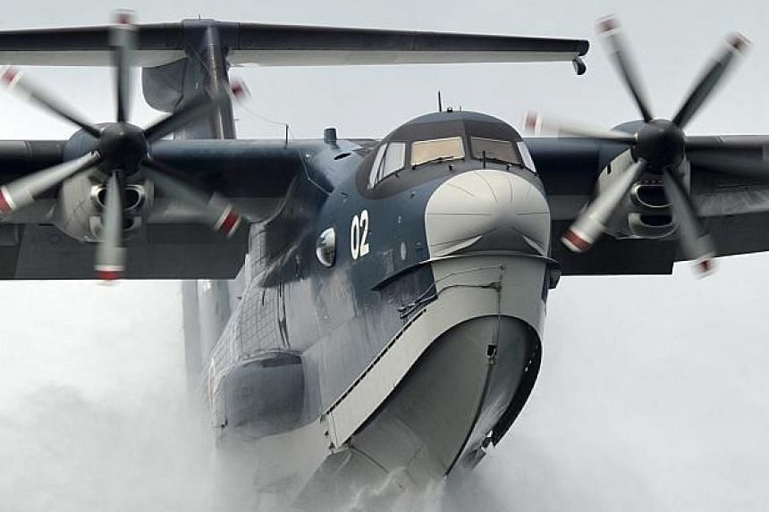 A Japan Maritime Self-Defence Forces US-2 search-and-rescue amphibian plane, manufactured by ShinMaywa Industries Ltd, is seen in this file handout photo released by the Japan Maritime Self-Defence Forces and obtained by Reuters on November 4, 2013.