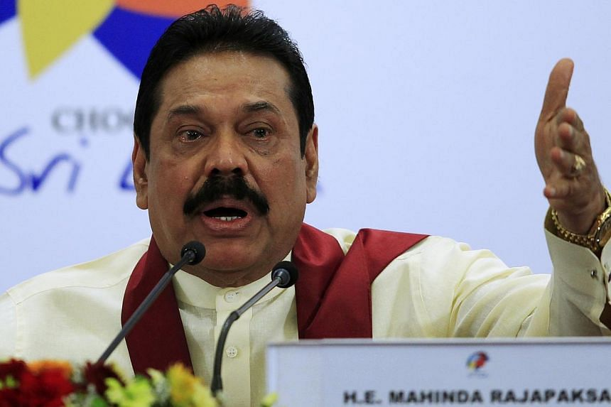 "Sri Lankan President Mahinda Rajapaksa gestures as he speaks during a news conference at the Commonwealth Heads of Government Meeting (CHOGM) in Colombo on Nov 17, 2013. An international inquiry into war crimes in Sri Lanka would bring ""chaos"", and t"