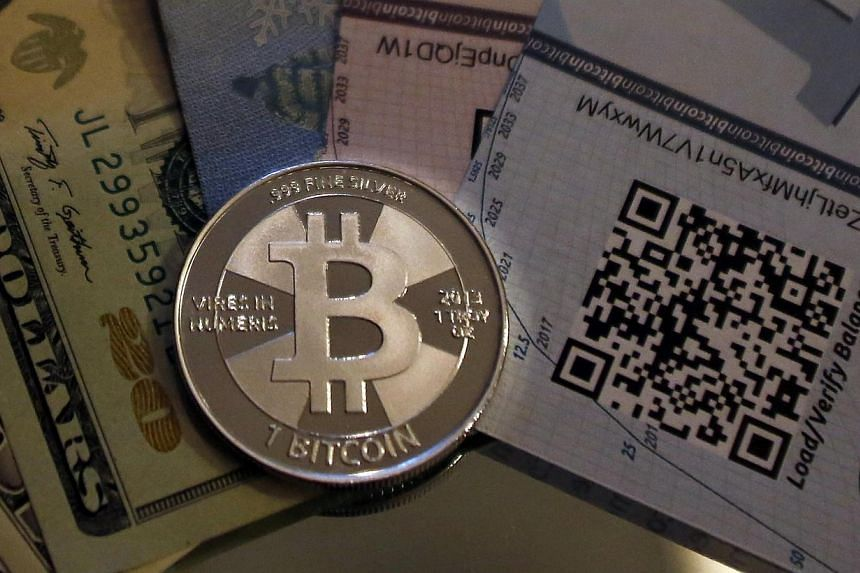 A mock bitcoin is shown in this photo illustration in Sandy, Utah, on Sept 17, 2013. United States prosecutors on Jan 27, 2014, announced charges against two men operating Bitcoin exchange businesses for attempting to sell US$1 million (S$1.3 mi