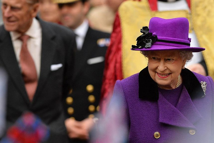 Britain's Queen Elizabeth II arrive for a visit to Southwark Cathedral in London on Nov 21, 2013. British lawmakers on Jan 28, 2014, urged Queen Elizabeth II's royal household to do more to reduce running costs and produce clearer plans for the monar