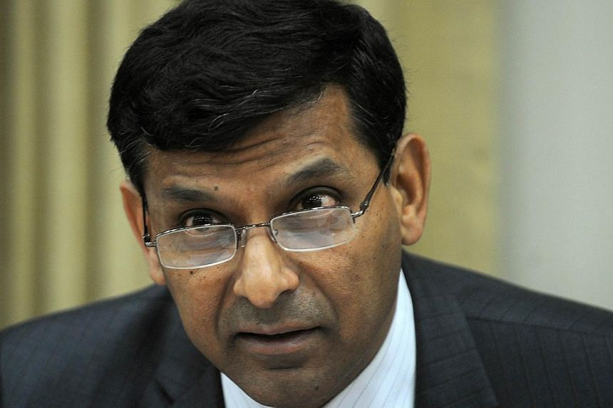 A file picture of Reserve Bank of India (RBI) governor, Raghuram Rajan, at the RBI headquarters in Mumbai on December 18, 2013. India's central bank raised key interest rate by 25 basis points on Jan 28, 2014. --PHOTO: AFP