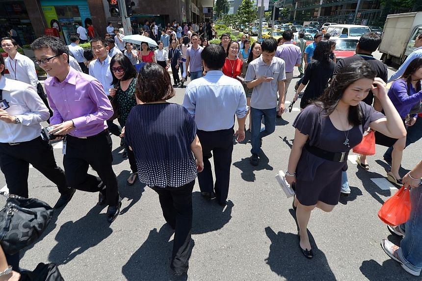 Pedestrians crossing a road at Shenton Way, on 30 Aug 2013.Singapore remains a largely conservative society in which pre-marital sex and having a child out of wedlock are still frowned upon. -- FILE PHOTO: ALPHONSUS CHERN